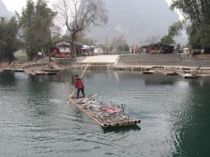 Getting Bikes Across the River via Bamboo Raft