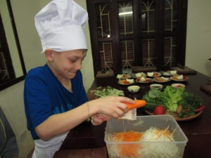 Braxton grates green papaya and carrots