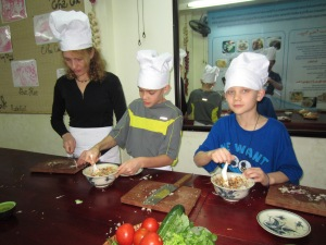 Prep cooks hard at work on spring roll filling
