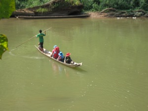 The boys enter the Nam Ha NPA via the Nam Tha River on a tippy canoe