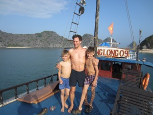 Three boys on a boat, Ha Long Bay
