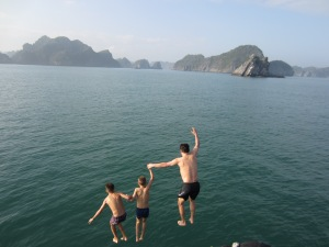 Three boys off a boat, Ha Long Bay