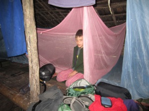 Henry on jungle camp group sleeping platform
