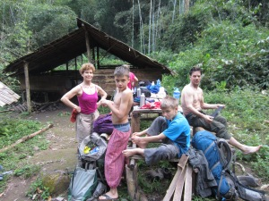 Coco and her boys pulling in to jungle camp, Nam Ha NPA, Laos