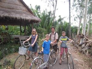 Riding bikes to town, Kampot