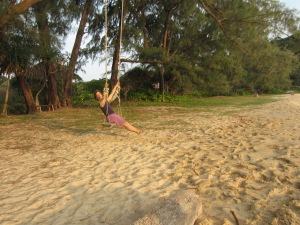 Coco swinging at Lazy Beach, Koh Rong Saloem, Cambodia