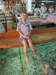 Braxton getting a (ticklish?) foot treatment at Dr. Fish, Khao San Rd., Bangkok, Thailand