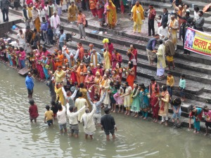 Devotees begin to gather on the Bagmati ghats in anticipation of Maha Shivaratri, Pashupatinath