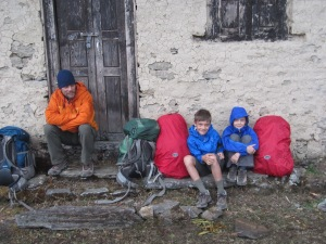 Hunkering down during rainstorm on the way to Foprang Danda