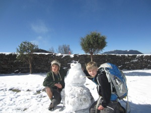 Carolina boys learn to make a snowman, front yard of the yak cheese factory, Shin Gompa