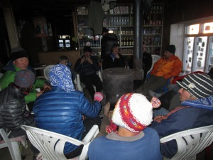 Staying warm with fellow trekkers, Laurebina Yak