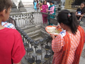 Preparing the butter lamps around the Nagpura (water symbol), Swayambhunath