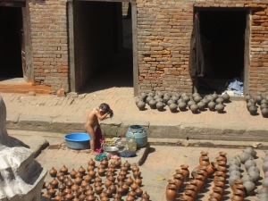 Bath time with plastic, metal and clay vessels, Bhaktapur