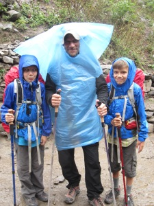 Strange man with trekking poles and high-end rain gear, Manaslu Circuit