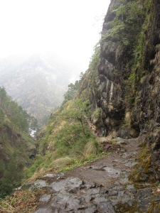 Climbing into the Lower Tsum Valley on a rainy day with the Siyar Khola far below