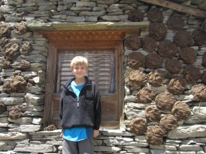 Braxton and a wall full of yak dung fuel, Burji