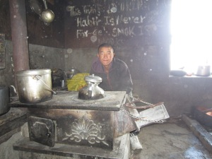 A monk and his cooking stove, Mu Gompa