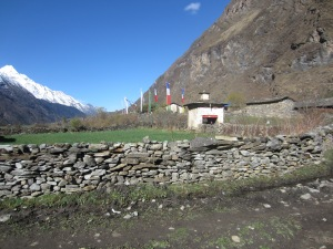 Small village with village gate in foreground, Upper Tsum Valley