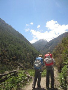 Boys hiking out on a sunny day, entering Lower Tsum Valley