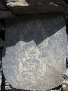 Buddha images begin to appear on the mani walls, Manaslu Circuit